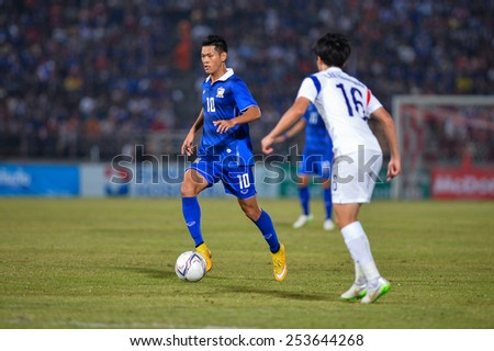 NAKHON RATCHASIMA THA-Feb07:Pokkhao Anan#10 of Thailand contols the ball during the 43rd King's cup match between Thailand and Korea Rep at Nakhon Ratchasima stadium on February07,2015 in Thailand - stock photo