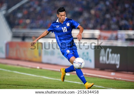 NAKHON RATCHASIMA THA-Feb07:Pokkhao Anan of Thailand in action during the 43rd King's cup match between Thailand and Korea Rep at Nakhon Ratchasima stadium on February07,2015 in Thailand. - stock photo
