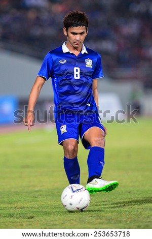 NAKHON RATCHASIMA THA-Feb07:Thitipan Puangchan of Thailand kicks a ball during the 43rd King's cup match between Thailand and Korea Rep at Nakhon Ratchasima stadium on February07,2015 in Thailand. - stock photo