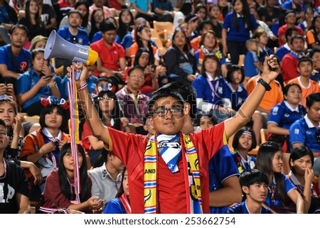 NAKHON RATCHASIMA THA-Feb07:Unidentified fans of Thailand cheer during  the 43rd King's cup match between Thailand and Korea Rep at Nakhon Ratchasima stadium on February07,2015 in Thailand - stock photo
