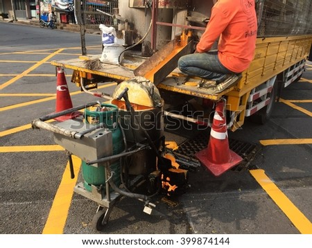Nakhon Ratchasima,Thailand-April 03,2016 : Machine and worker at road construction use for road and traffic sign painting .
