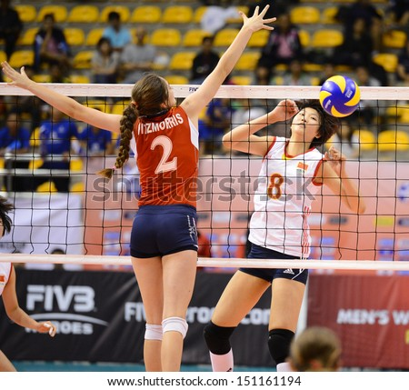 Nakhon Ratchasima, Thailand - AUG 4:Xinyue Yuan #8 of China in action during FIVB Volleyball Girls U18 World Championship at Chatchai Hall on August 4, 2013 in Nakhon Ratchasima, Thailand.