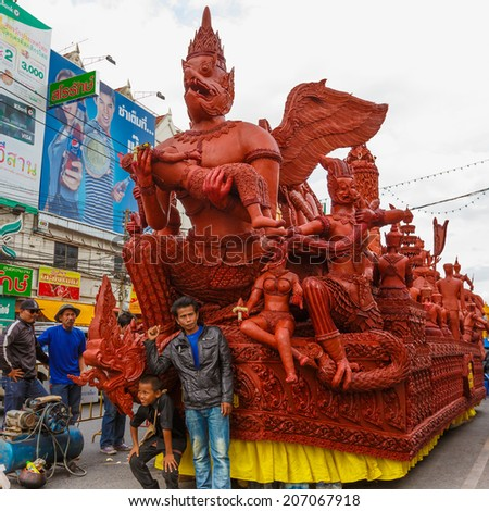 NAKHON RATCHASIMA, THAILAND - JULY 11 : The traditional candle procession festival of Buddha on July 11, 2014 in Nakhon Ratchasima, thailand.