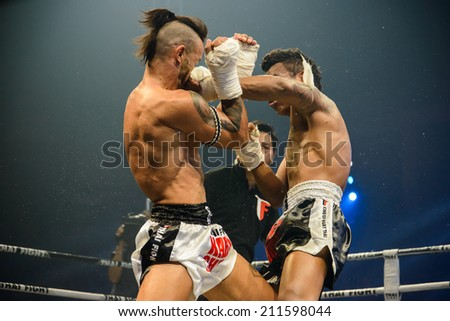 Nakhon Sawan, THAILAND- August 16 : Unidentified boxers compete in Thai Fight:Muay Thai World's Unrivaled Fight on August 16, 2014 , in Nakhon Sawan , Thailand - stock photo