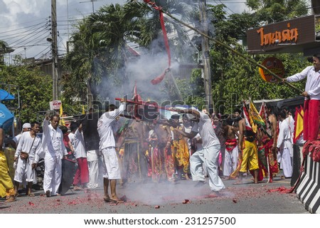 NAKHON SI THAMMARAT, THAILAND - OCTOBER 25: Taoist devotees participate in a street procession of Nakhon Si Thammarat vegetarian festival on October 25, 2014 in Nakhon Si Thammarat province, Thailand.