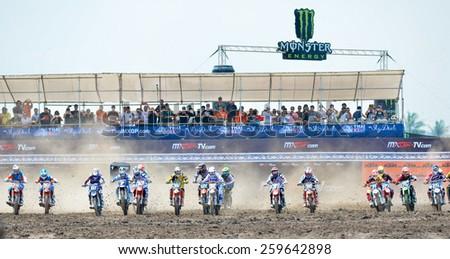 Nakhonchaisri,THAI-Mar8:Motocross riders perform on the Thai MX GP World Championship at thailand Circuit on March08,2015 in Nakhonpathom,Thailand.  - stock photo