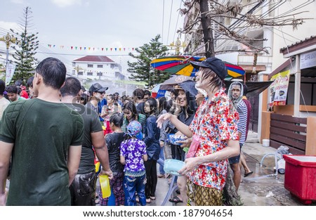 NAKHONPATHOM - APRIL 16: Songkran Festival is celebrated in Thailand as the traditional New Year's between 12 April to 16 April at Ton Son Road on April 16, 2014 in Nakhonpathom, Thailand