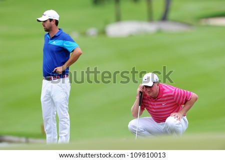 NAKHONPATHOM,THAILA ND - AUG 9:Richard Finch of ENG  lines up prior to putting during hole9 day one of the Golf Thailand Open at Suwan Golf&Country Club on August 9, 2012 in Nakhonpathom Thailand