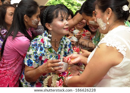 NAKHONRATCHASIMA, THAILAND - APRIL 11: Thai people celebrate Songkran the new year water festiva  by giving garlands to their seniors and asked for blessings on April 11, 2014 in Nakhonratchasima, Thailand.  - stock photo