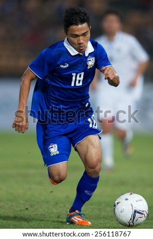 NAKHONRATCHASIMA THAILAND-FEB 04:Chanathip Songkrasin of Thailand run with the ball during the 43rd King's cup between Thailand and Uzbekistan at Nakhon ratchasima stadium on Feb 04,2015 in Thailand.
