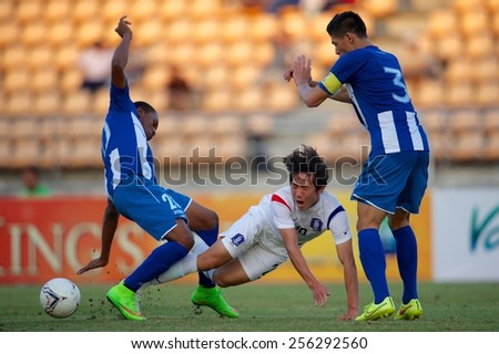 NAKHONRATCHASIMA THAILAND-FEB 04:Kang Sangwoo (white)of South Korea in action during during the 43rd King's cup between Honduras and South Korea at Nakhon ratchasima stadium on Feb04,2015 in Thailand. - stock photo