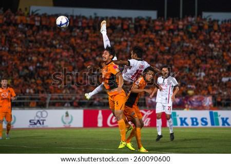 NAKHONRATCHASIMA THAILAND-FEB15:Satoshi Nagano(no.5)of Nakhon Ratchasima in action during the Thai Premier League Muangthong Utd.and Nakhon Ratchasima at 80th Birthday Stadium on Feb15,2015inThailand. - stock photo