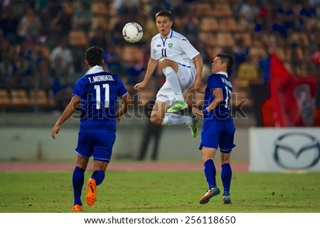 NAKHONRATCHASIMA THAILAND-FEBRUARY 04:Igor Sergeev (white) of Uzbekistan in action during the 43rd King's cup between Thailand and Uzbekistan at Nakhonratchasima stadium on Feb 04,2015 in Thailand.