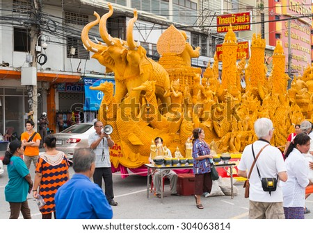 Nakhonratchasima Thailand-Jul 30,2015: Candle Festival parade from people. the day  of Buddhist Lent at road Muang Korat on July 30,2015 in,Nakhonratchasima ,Thailand. The big festival in Thailand