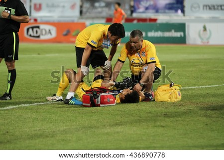 NAKHONRATCHASIMA THAILAND-JUN11: Doctors stand by for help injured player in action during ThaiLeague Pattaya United F.C.and Nakhon Ratchasima FCat 80th Birthday Stadium on June11,2016 in Thailand.