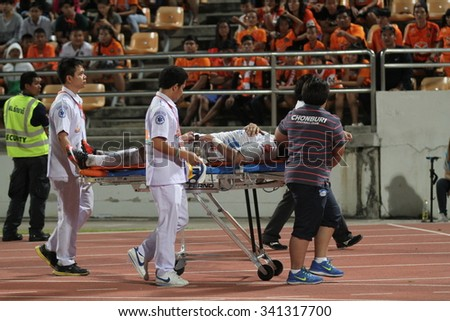 NAKHONRATCHASIMA THAILAND-NOV15: Doctors with injured player of Chonburi F.C.in action during ThaiPremierLeague Chonburi F.C.and Nakhon Ratchasima FCat 80th Birthday Stadium on Nov15,2015 in Thailand.