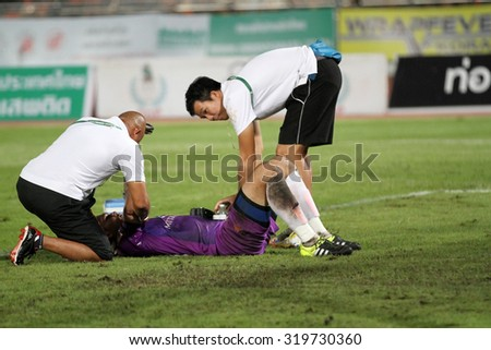 NAKHONRATCHASIMA THAILAND-SEP 19: Doctors with injured playerof Ratchaburi FCin action during ThaiPremierLeague Ratchaburi FCand Nakhon Ratchasima FCat 80th Birthday Stadium on Sep19,2015 in Thailand. - stock photo