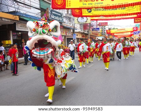 NAKHONSAWAN, NORTHERN/ THAILAND-JANUARY 26: Procession of Kwong Siew lions participate in Chinese New Year Celebrations on January 26, 2012 in Nakhonsawan.