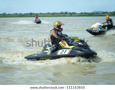 NAKHONSAWAN/THAILAND-AUG 12: Unidentified athletes drive jet ski during competition in Jet Ski Pro Asian Grand Prix 2012 at Boraped Swamp on Aug 12, 2012 in Nakhonsawan.