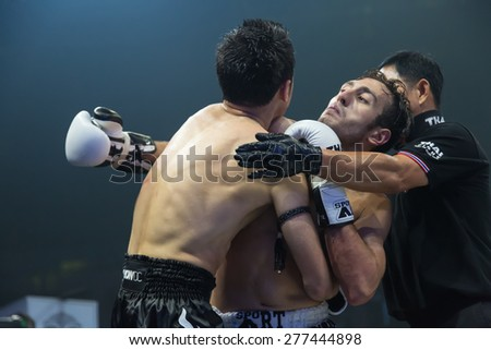 Nakhonsawan, Thailand - August 15, 2014 : Competition Finals to the Thai Boxer in World Muay Thai Fight 2014 at Nakhonsawan, Thailand on August 15, 2014.