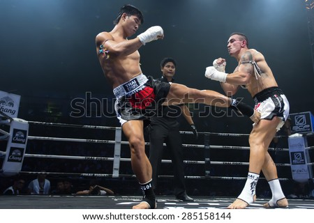 Nakhonsawan, Thailand - August 15, 2014: Competition Finals to the Thai Boxer in World Muay Thai Fight 2014 at Nakhonsawan, Thailand on August 15, 2014. - stock photo