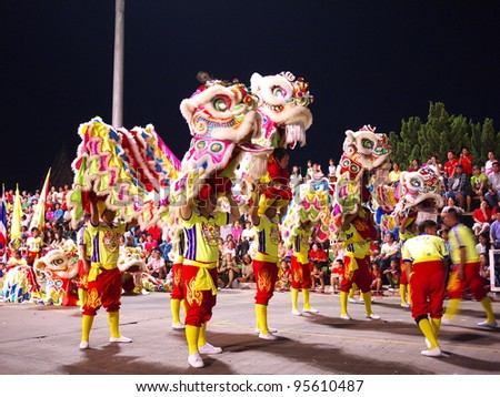 NAKHONSAWAN/ THAILAND-JANUARY 25: Showing of lion group manipulation in Chinese New Year Festival on January 25, 2012 in Nakhonsawan. Noted that there must be four persons per one lion manipulation.