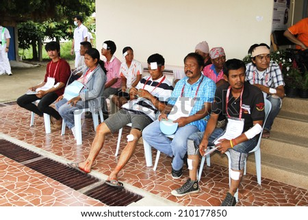 NAKHONSAWAN/THAILAND-JULY 31: Exercise Management for group accident on July 31, 2014 in Nakhonsawan. The victims wait for therapy at District Hospital.