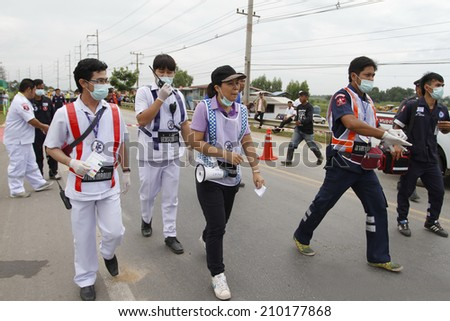 NAKHONSAWAN/THAILAND-JULY 31: Exercise Management for group accident on July 31, 2014 in Nakhonsawan. Rescue and Medical Personnel teams go to the scene of accident. - stock photo