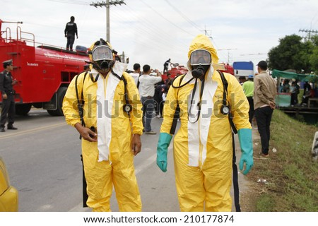 NAKHONSAWAN/THAILAND-JULY 31: Exercise Management for group accident on July 31, 2014 in Nakhonsawan. The Chemical operation team personnel. - stock photo