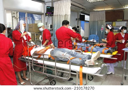 NAKHONSAWAN/THAILAND-JULY 31: Exercise Management for group accident on July 31, 2014 in Nakhonsawan. Specialist teams examining severe traumatic victims. - stock photo