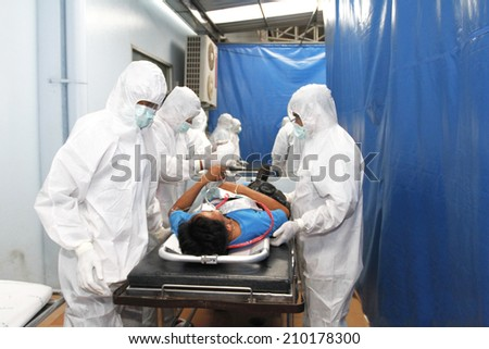 NAKHONSAWAN/THAILAND-JULY 31: Exercise Management for group accident on July 31, 2014 in Nakhonsawan. The severe traumatic victims are managed by the specialist teams in Universal Precaution Suits. - stock photo