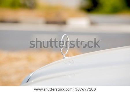 NAKHONSAWAN THAILAND - MARCH 08 : Mercedes-Benz logo show on font car on the road. on March 08, 2016 in Nakhonsawan, Thailand. - stock photo