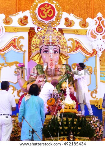 NAKHONSAWAN/ THAILAND-SEPTEMBER 11, 2016: Head of Brahmans covers cloths to the Huge Ganesh idol before carrying to the river at the end of Ganesh God Anniversary Birthday Festival.