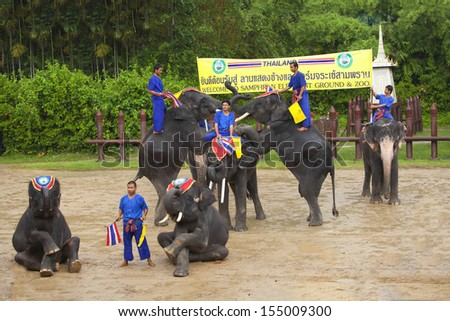 NAKOM PATHOM THAILAND, September 14, 2013 : Elephants and Thai warriors performing a show in September 14, 2013 in Nakom Pathom, Thailand.