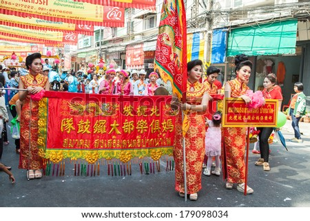 NAKORN SAWAN, THAILAND - FEBRUARY 2: An unidentified participants in Nakornsawan chinese newyear festival on February 2, 2014 in Kosi road, Nakorn Sawan, Thailand.  - stock photo