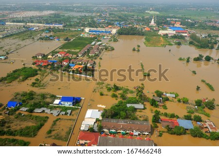 NAKORNRACHARSIMA, THAILAND - OCTOBER 20: Heavy flooding from monsoon rain from aerial view on October 20, 2010 in Nakornrachasima, Thailand.  - stock photo