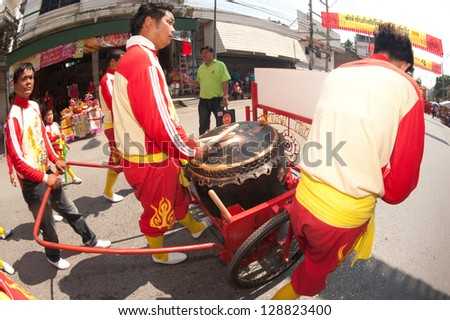 NAKORNSAWAN,THAILAND - FEBRUARY 13: A drum performer participates in the Chinese New Year Parade on February 13, 2013 in the Nakornsawan City in Middle of Thailand.