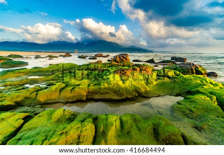 Nam O Beach is a beautiful beach in Danang city , Vietnam. Beautiful moss rocks at the beach is interesting for travel and take a photo.