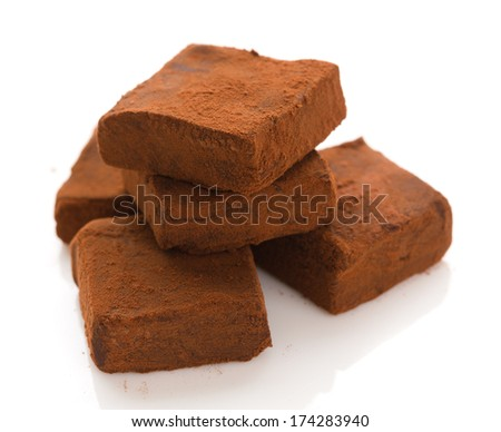 Nama Chocolate (also called raw chocolate) is a modern Japanese confectionery of plain ganache (chocolate mixed with heavy cream and rum), covered with cacao powder. - stock photo