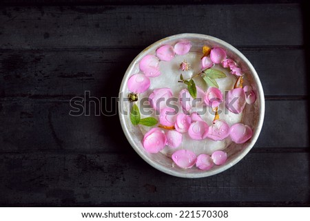Namaste. Rose petals floating on water (traditional south Indian greeting). - stock photo
