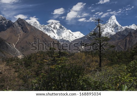 NAMCHE BAZAR, NEPAL - CIRCA OCTOBER 2013: view of the Himalayas (Everest, Lhotse, Ama Dablam) from near Namche Bazaar circa October 2013 in Namche Bazar. - stock photo
