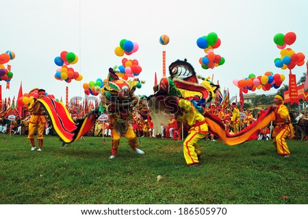 NAMDINH, VIETNAM - APRIL 02: A group of unidentified boys dance with their colorful lion during performances at Phu Giay festival on APRIL 02, 2014 in NAMDINH City, VIETNAM - stock photo