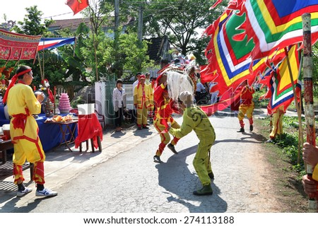 NAMDINH, VIETNAM - April 30: A group of unidentified dancer with their colorful dragon during the traditional festival celebrations in the Tet Lunar New Year on Apri; 30, 2015 in NamDinh.