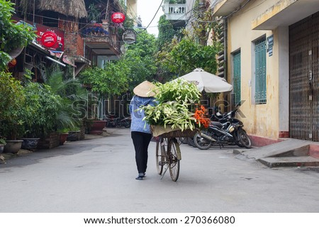 NAMDINH, VIETNAM - April 18, 2015: Unidentified vendor at the small market on April 18, 2015 in NAMDINH, VIETNAM. This is a small market on street of VIETNAM.