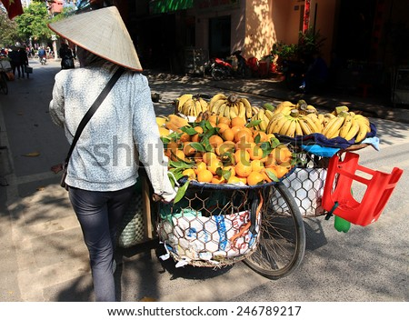 NAMDINH, VIETNAM December 30, 2014: the life of the fruit vendors on the streets of Vietnam. Small business is mainly in Vietnam.