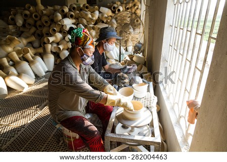 NAMDINH, VIETNAM May 9, 2015: workers producing bamboo vase. Item crafts are major export items Vietnam.