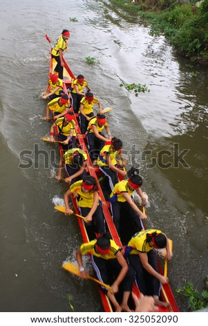 NAMDINH, VIETNAM - OCT 3: Group people sailing on small river in countryside at October 3, 2015 in Namdinh, vietnam. This is tradition festival of farmer in village.