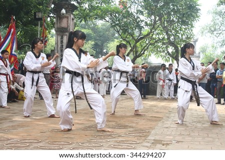 NAMDINH, VIETNAM - OCTOBER 2, 2015: Vietnam Taekwondo kid training in the park at October 2, 2015 in Namdinh, Vietnam.