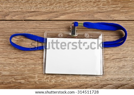 Name id card badge with cord (rope) on wooden table - stock photo
