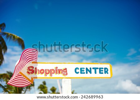 Name shopping center on  blue sky  with sunhat